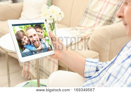 Video call and chat concept. Senior man video conferencing on tablet