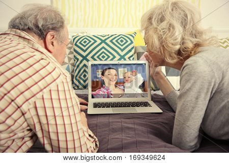Video call and chat concept. Senior people video conferencing on laptop
