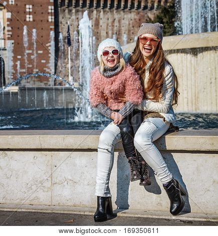 Happy Modern Mother And Daughter Tourists In Milan, Italy