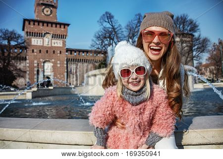 Smiling Modern Mother And Child Travellers In Milan, Italy