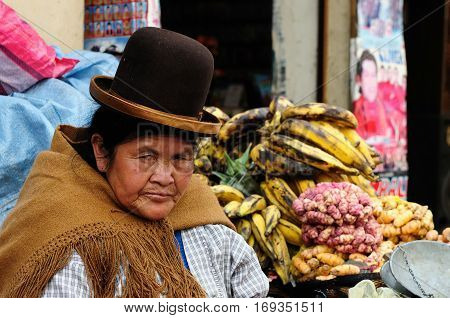 LA PAZ BOLIVIA - OCTOBER 26: woman in the ethnic dress is selling a vegetable of the capital city of Bolivia of the city La Paz in South America in October 26 2011
