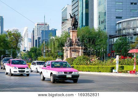 MEXICO CITY,MEXICO - DECEMBER 28,2016 : Street scene next to the Columbus Monument at Paseo de la Reforma in Mexico City