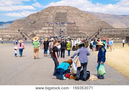 TEOTIHUACAN,MEXICO - DECEMBER 26,2016 : Tourists buying souvenirs at the Teotihuacan archaeological site near Mexico City