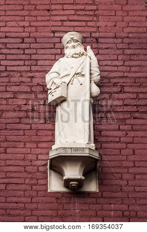 Statue of Saint Jacob on the walls of a cathedral in Amsterdam