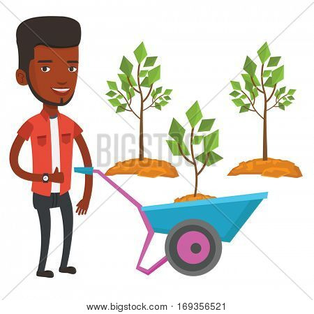 An african gardener with wheelbarrow on a background of newly planted trees. Gardener pushing wheelbarrow with tree and dirt in the park. Vector flat design illustration isolated on white background.