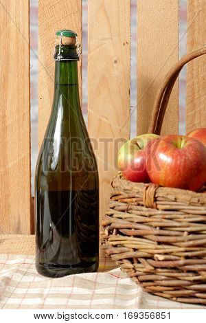 bottle of cider of Normandy with fresh apples