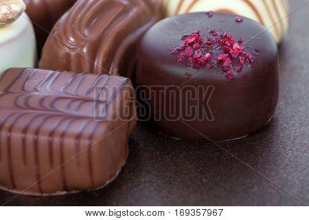 Gourmet bonbons, aka bon-bons or truffles made of milk chocolate. Closeup macro.