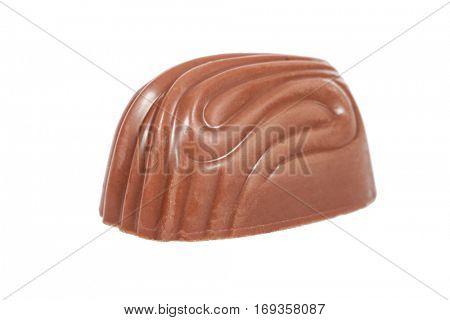 Gourmet bonbon, aka bon-bon or truffle made of milk chocolate. Closeup macro detail isolated on white background