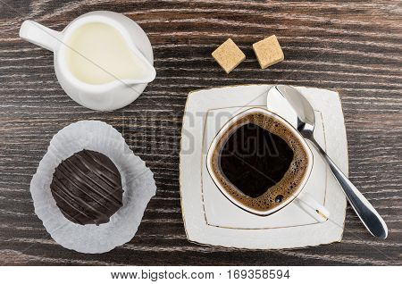 Cup Of Coffee, Milk In Jug, Chocolate Cake And Sugar