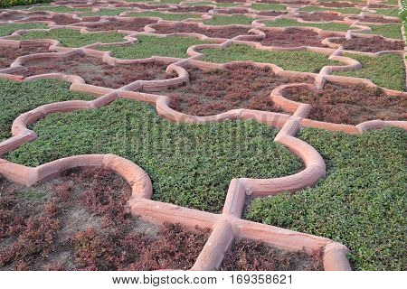 AGRA, INDIA - FEBRUARY 14,2016: Angoori Bagh or Garden of Grapes at Agra Fort. It's symmetrical garden near Dewan-e-Khaas. It was a private garden for Mughal ladies. UNESCO World heritage site in Agra