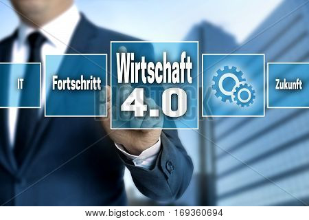 Wirtschaft 4.0 (in German Economy) Touchscreen Is Operated By A Businessman
