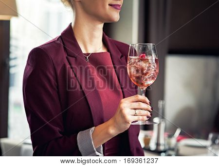 Freshness every day. Glass of very cold water in girl's hand transparent glass. Quench their thirst.