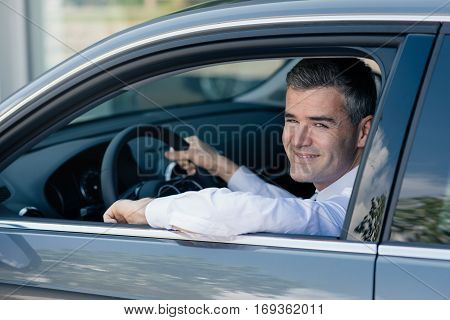 Man Driving A Brand New Car