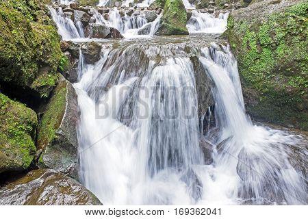 Waterfall in tropical area of Jogjakarta Indonesia