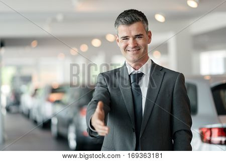 Car Dealer Giving A Handshake