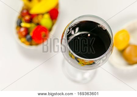 The glass of fine red wine in the background colored dessert french wine