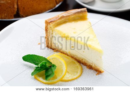 Delicious lemon cheesecake on a white plate