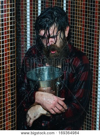 Energized Man With Metal Bucket