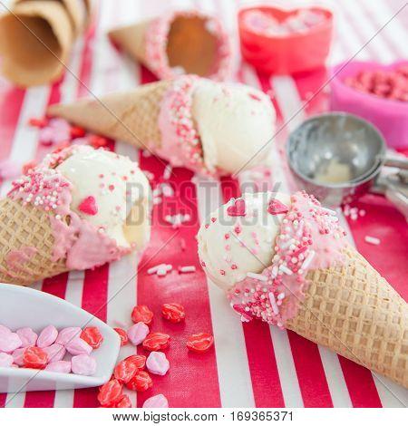 Vanilla ice cream cones with pink sprinkles