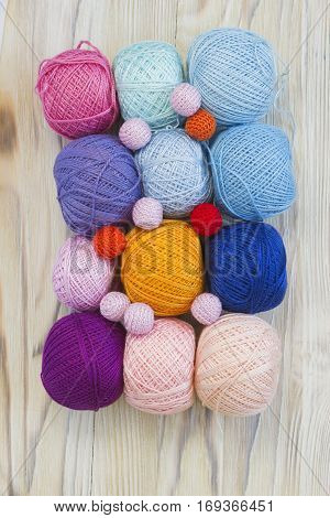 Bright balls of cotton yarn and handmade beads for knitting crochet and creative craft work