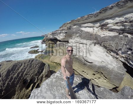 Man taking a selfie in Rocks, Australia