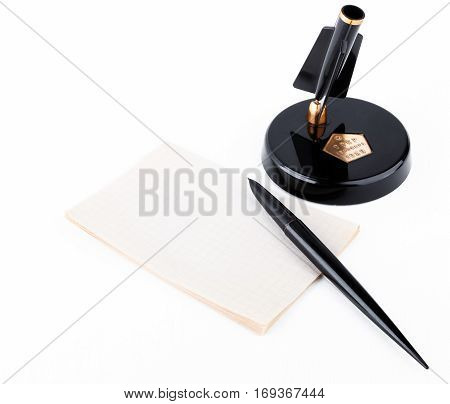 old soviet fountain pen with stand and sheet for records on white background
