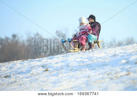 Two Children On Sled