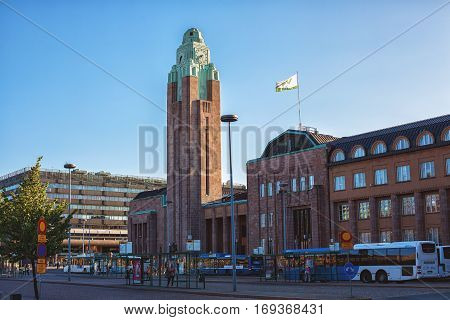 HELSINKI FINLAND - AUGUST 8 2013: Outside the Helsinki Central Railway Station. Opened in 1919 the train station is one of the most famous landmarks in the Finnish capital.