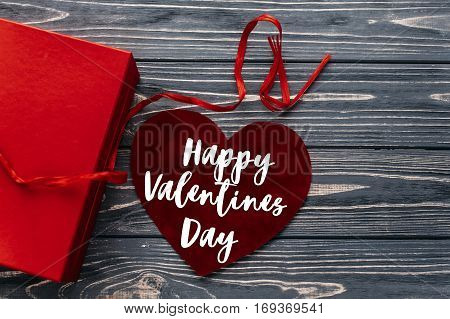 Happy Valentines Day Text Sign Card. Stylish Red Present And Velvet Heart Ribbons Flat Lay On Black