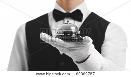 Bellboy holding bell on his hand, close up