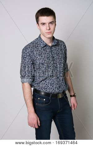 Portrait Of A Serious Young Man In Shirt