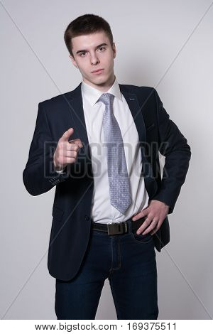Portrait Of A Young Businessman Pointing His Finger