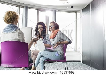 Businesswomen discussing in creative office