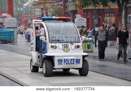 BEIJING, CHINA - JUN.24, 2012: Electric Police Car patrol in the street in Beijing, China.