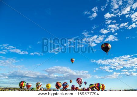 Hot Air Balloons fly over the city of Albuquerque New Mexico during the mass ascension at the annual International Hot Air Balloon Fiesta in October 2016