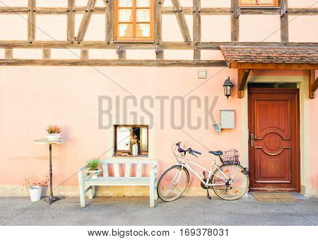 wall of half-timbered old house painted in pink - details of Rothenburg ob der Tauber, Germany