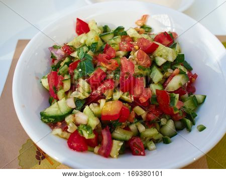 Classic famous Israeli salad made of freshly cut vegetables