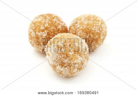 Castagnole alla romana fried dough balls with sugar on a white background