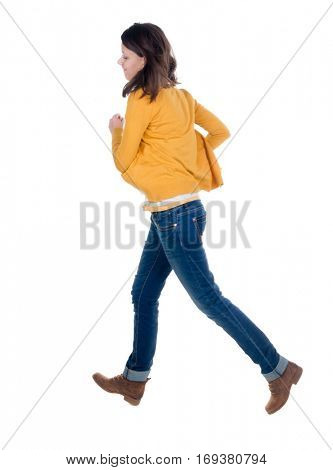 back view of running  woman in yellow cardigan. beautiful brunette girl in motion. backside view of person.  Rear view people collection. Isolated over white background.