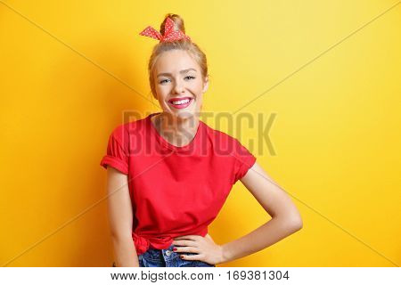 Young cool woman on yellow background