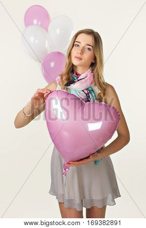 Sweet Girl In Spring Style With Baloons. Valentine Day
