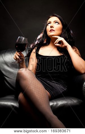 young woman enjoying a glass of red wine