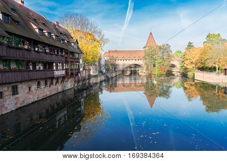Old town of Nuremberg with half-timbered houses and Hallertorbrucke bridge over Pegnitz river, Germany