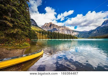 In shallow moored boat. The mountain Emerald lake. The concept of eco-tourism. Sunny day in autumn Yoho National Park, Canada
