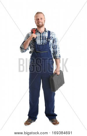 Handsome plumber with pipe wrench and tool box isolated on white