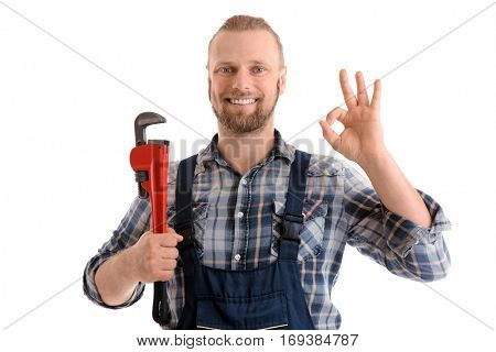 Portrait of handsome plumber with pipe wrench isolated on white