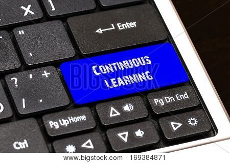 Business Concept - Blue Continuous Learning Button On Slim