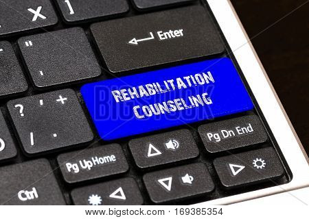 Business Concept - Blue Rehabilitation Counseling Button On Slim