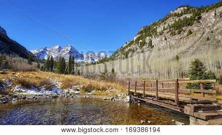 Maroon Bells Mountain Landscape With Wooden Bridge.