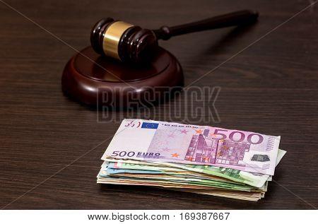 Wooden Gavel On Euro Banknotes On Wooden Desk.